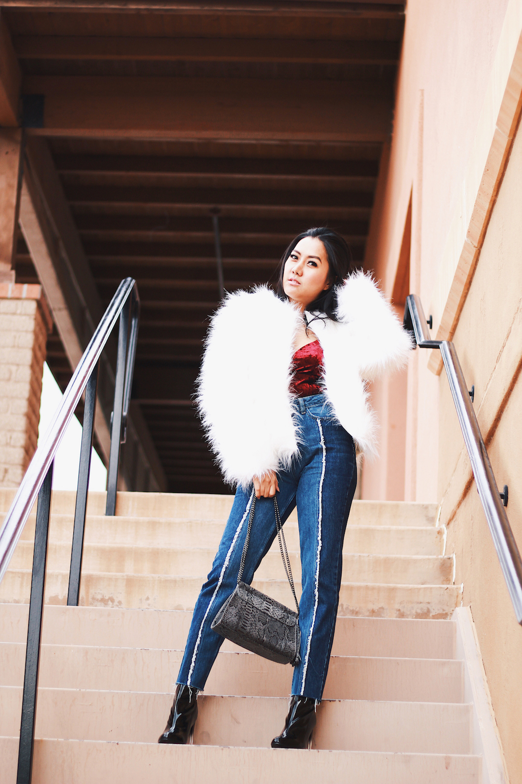 Holiday-Outfit-Ideas-Faux-Fur-Jacket-Velvet-bodysuit-and-jeans