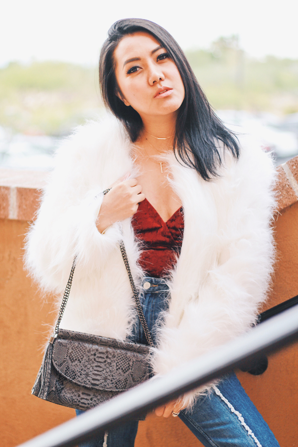 Holiday-Outfit-Ideas-Faux-Fur-coat-and-jeans