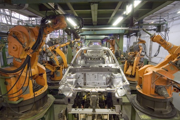 Kuka Industrial Robots assembling car bodies. Image by Mixabest from Wikipedia and available under the CC-BY-SA License
