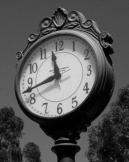 Street iron work clock