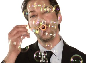 Manager blowing Soap Bubble