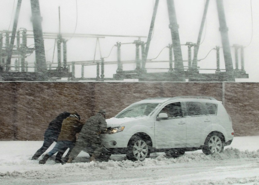 Pushing Car in Snowstorm