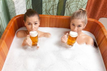 Women in Tub with Beer
