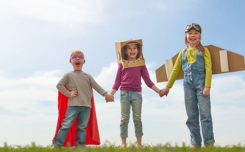 Children with Cardboard Box Toys