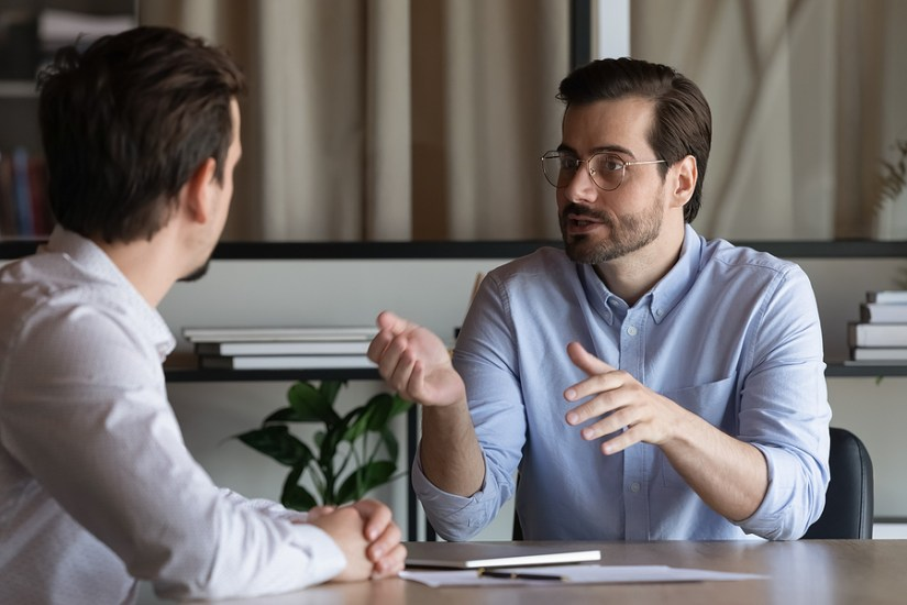 Manager discussing with Employee