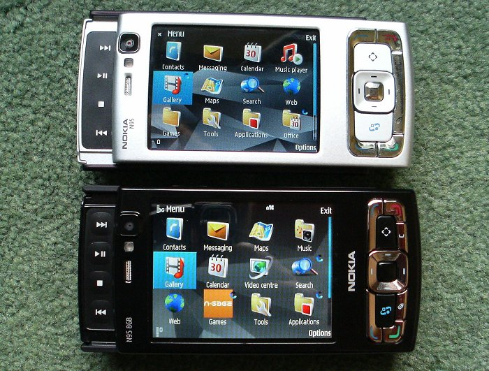 Side by side. Note dimpled media keys and larger screen on the 8GB model