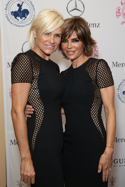 BEVERLY HILLS, CA - OCTOBER 11: TV personalities Yolanda Foster (L) and Lisa Rinna attend Mercedes-Benz presents the Carousel of Hope Ball benefitting Barbara Davis Center for Diabetes on October 11, 2014 in Beverly Hills, California. (Photo by Chelsea Lauren/Getty Images for Mercedes-Benz)