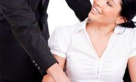 Couple romancing in office/freedigitalphotos