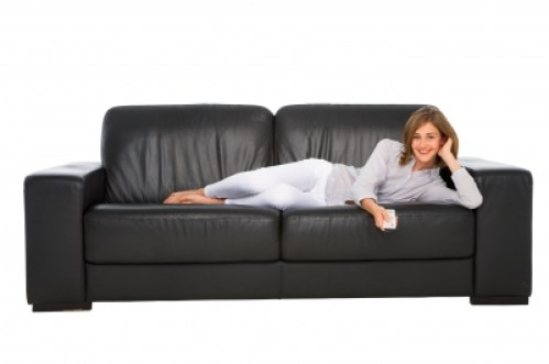A girl sitting on sofa/freedigitalphotos