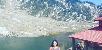 Rachna posing in front of Kareri Lake