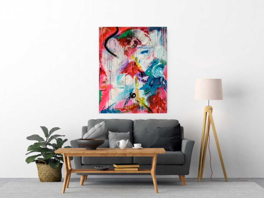Modern livingroom with bright coloured abstract art canvas on wall