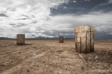 """The monumental stone pillars of the Wilcox dry lakebed. Centerpiece for a gallery show in Tucson, Arizona and used in print and television media to announcethe opening of the Fall 2010 fine art galleryseason. Glass framed inkjet, 48"""" x 32"""", Fine Art Pearl archival paper. Photography and Installation: Allan Sturm Gallery: The FRONT @ Platform Gallery, Lin Cohorn Tucson Weekly Article: Ready for Receptions?"""