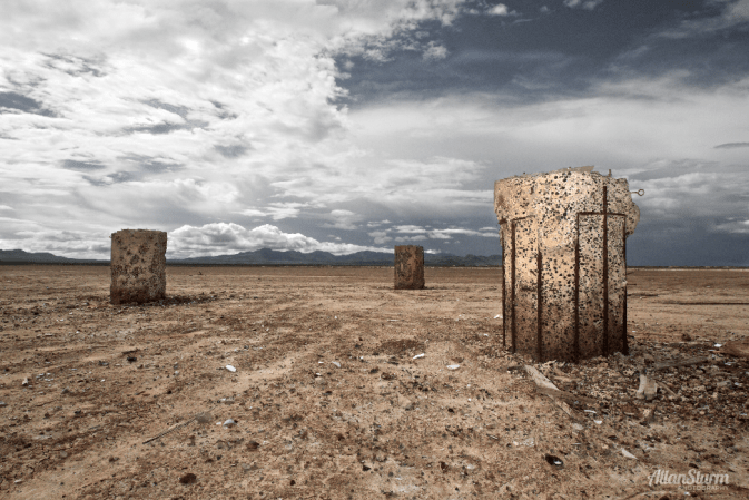 "The monumental stone pillars of the Wilcox dry lakebed. Centerpiece for a gallery show in Tucson, Arizona and used in print and television media to announce the opening of the Fall 2010 fine art gallery season. Glass framed inkjet, 48"" x 32"", Fine Art Pearl archival paper. Photography and Installation: Allan Sturm Gallery: The FRONT @ Platform Gallery, Lin Cohorn Tucson Weekly Article: Ready for Receptions?"