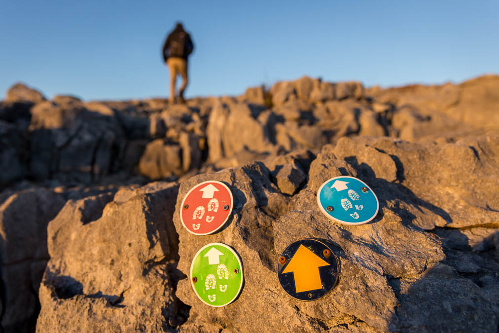 Brightly coloured trail markings on the rocks in the Burren to mark routes