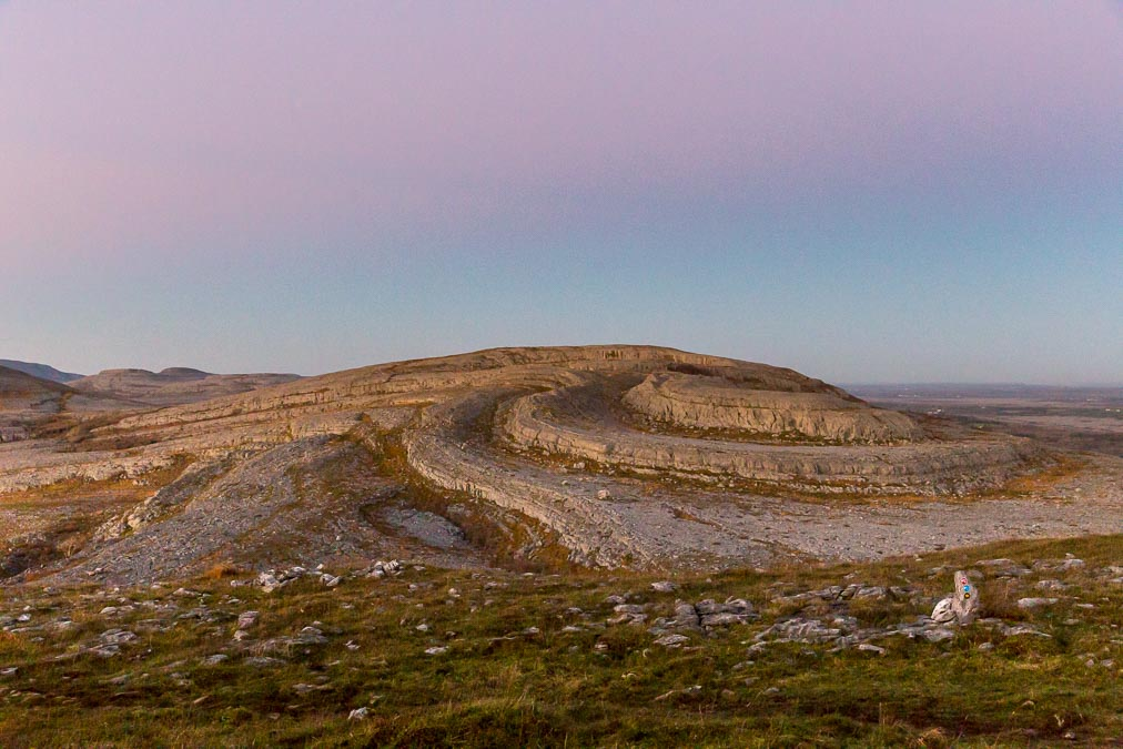 A pink evening sky above Sliabh Rua's twisted rocky summit.