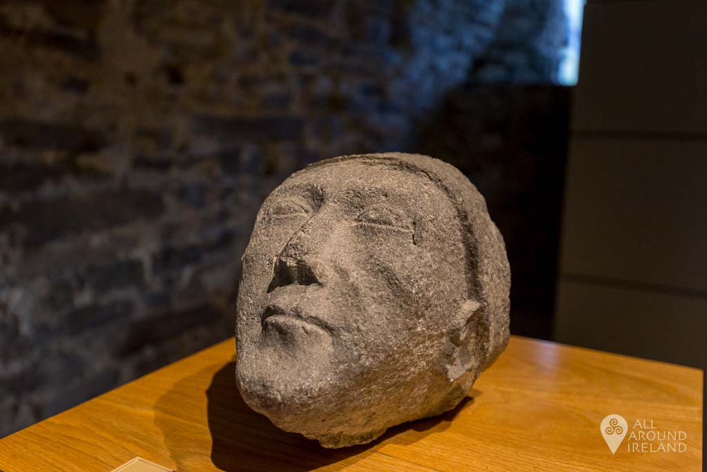 Stone human head among artefacts on display at Jerpoint Abbey in Kilkenny, Ireland.