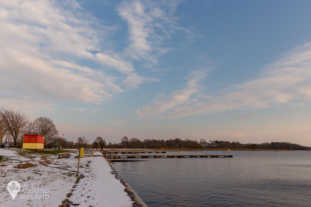 Snow surrounds the swimming area