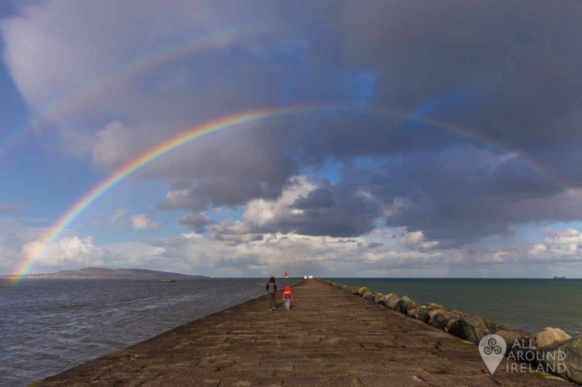 Double rainbow arching over the wall