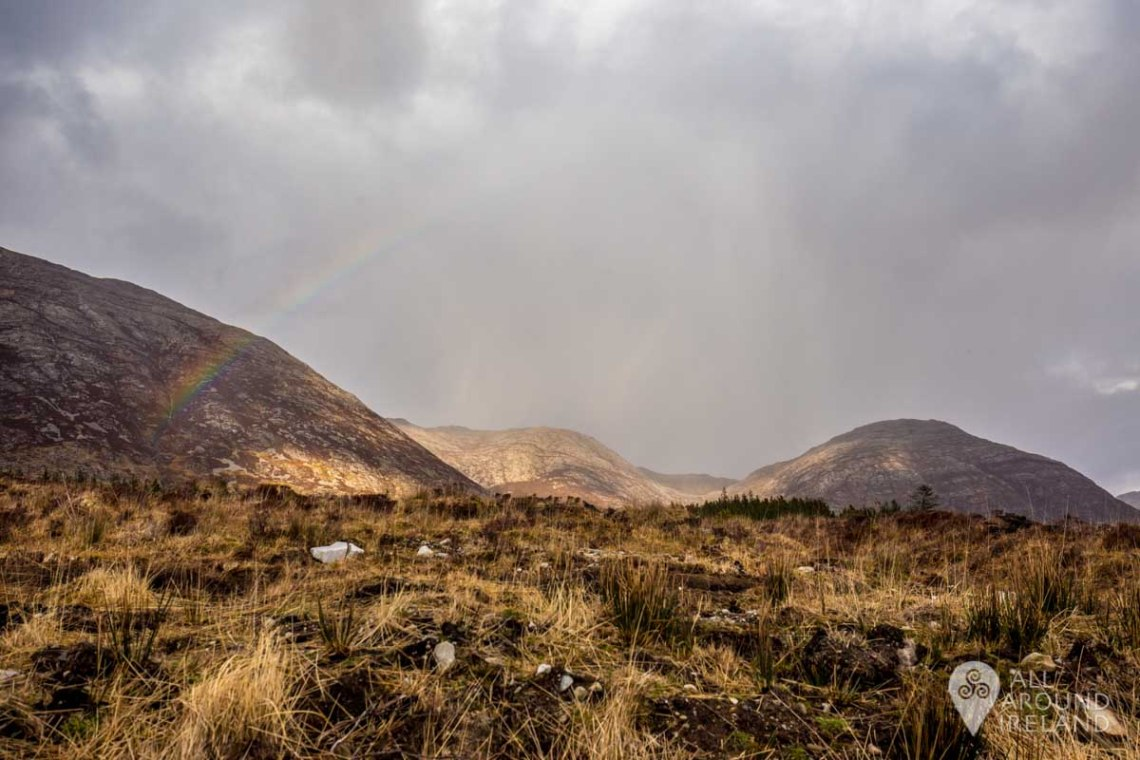 Dramatic skies and a rainbow at Lough Inagh Valley.