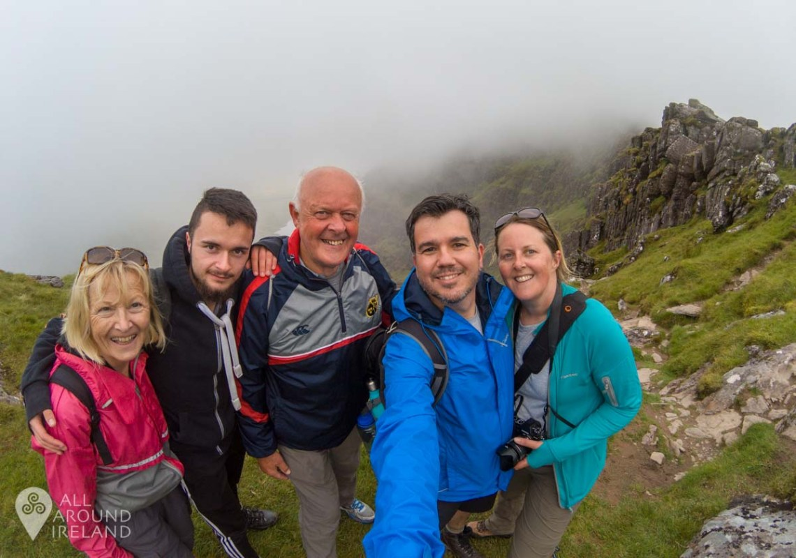 Family photo at the cloudy sub-summit of Mount Brandon