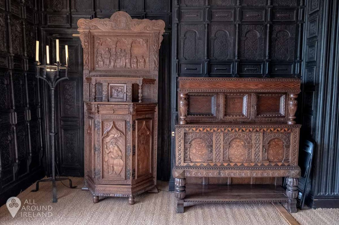 Elaborately carved furniture in the Oak Room at Malahide Castle, Dublin