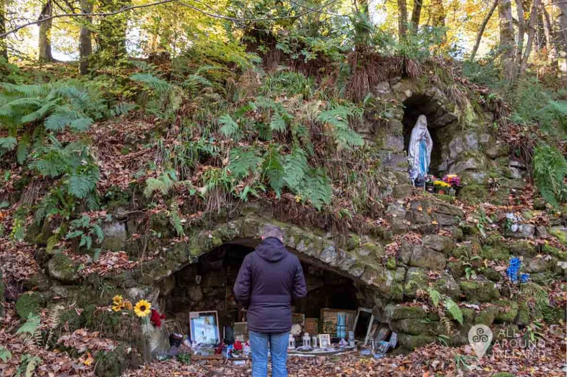 A man stands in front of the grotto in Glencree Valley, Co. Wicklow.
