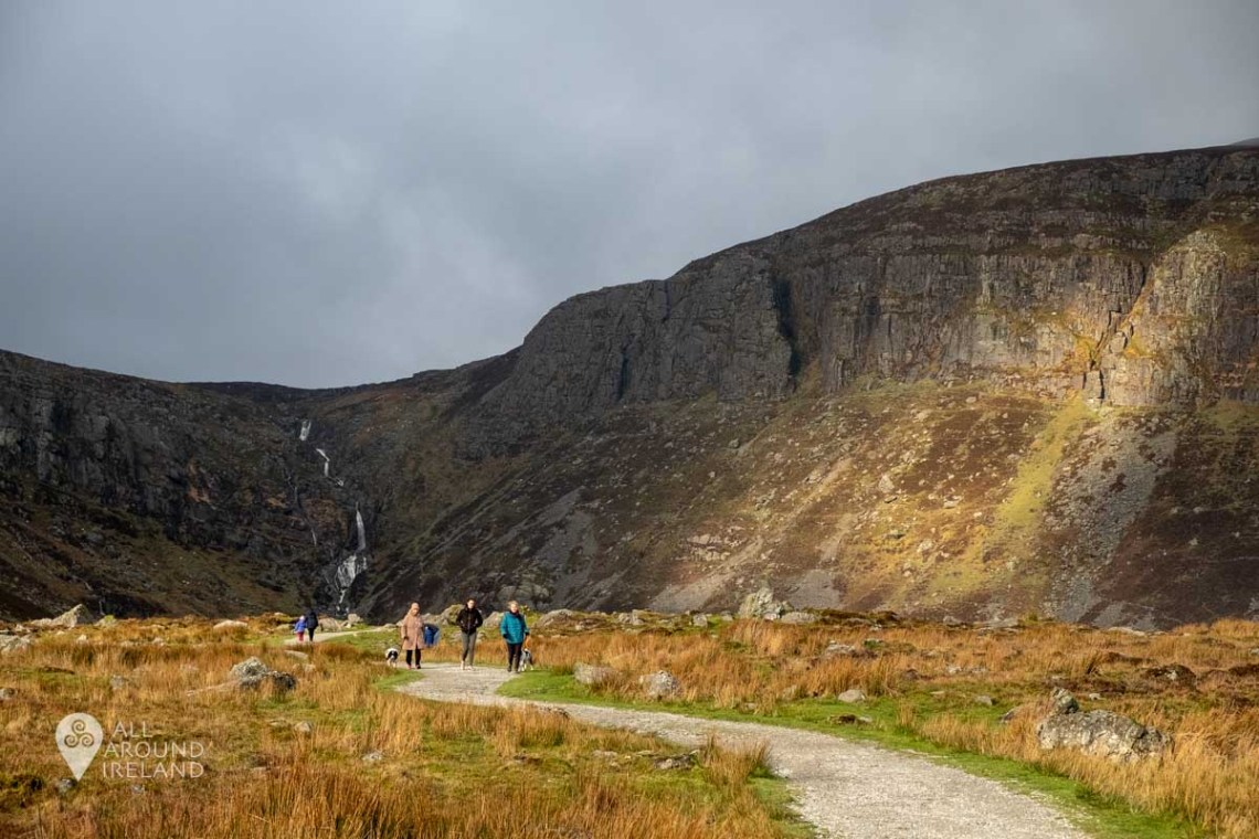 The sun breaks through the clouds creating dramatic lighting at Mahon Falls.