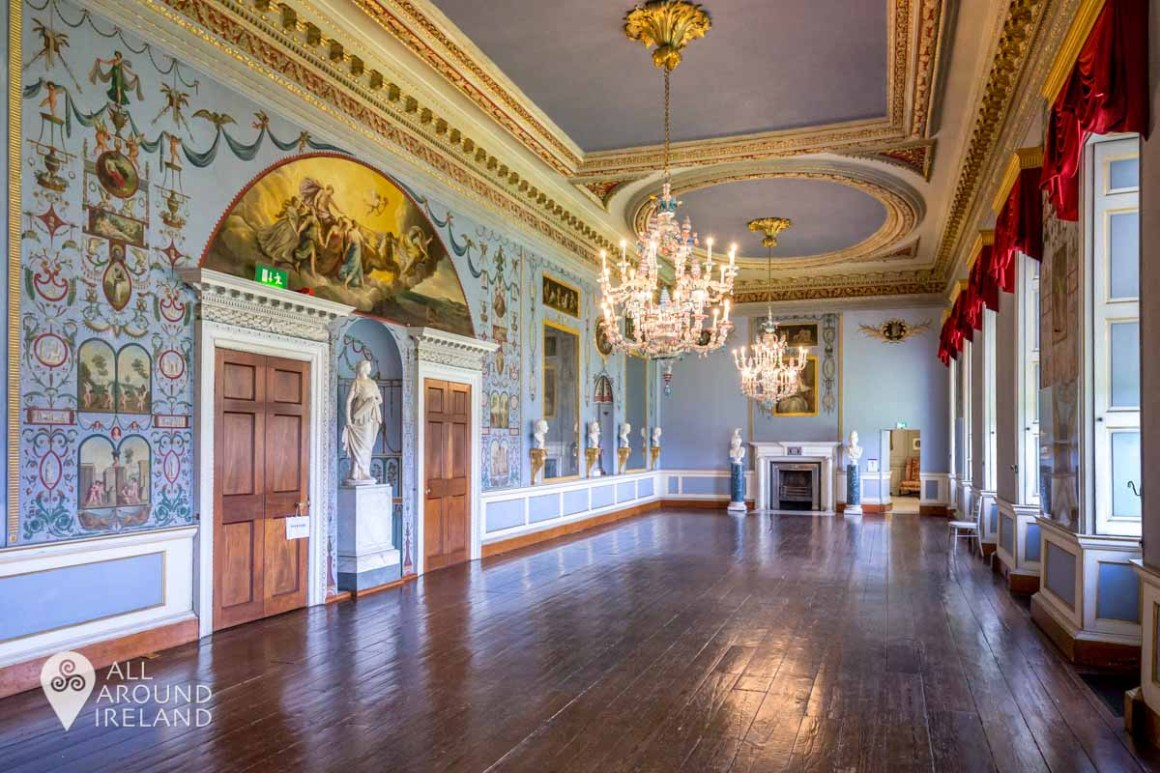 The Long Gallery was used for entertaining at Castletown. The walls are decorated with murals and there is a set of three rare murano glass chandeliers