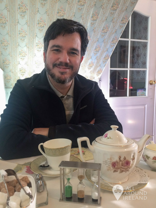 José waiting for his tea to brew. A timer is placed on the table so you know when it's ready.