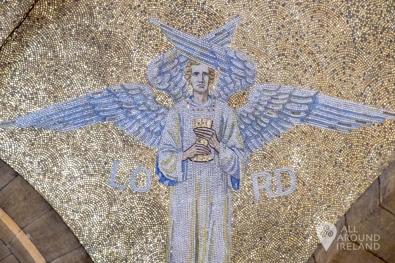 An angel surrounded by gold, part of a mosaic ceiling inside St Anne's Cathedral