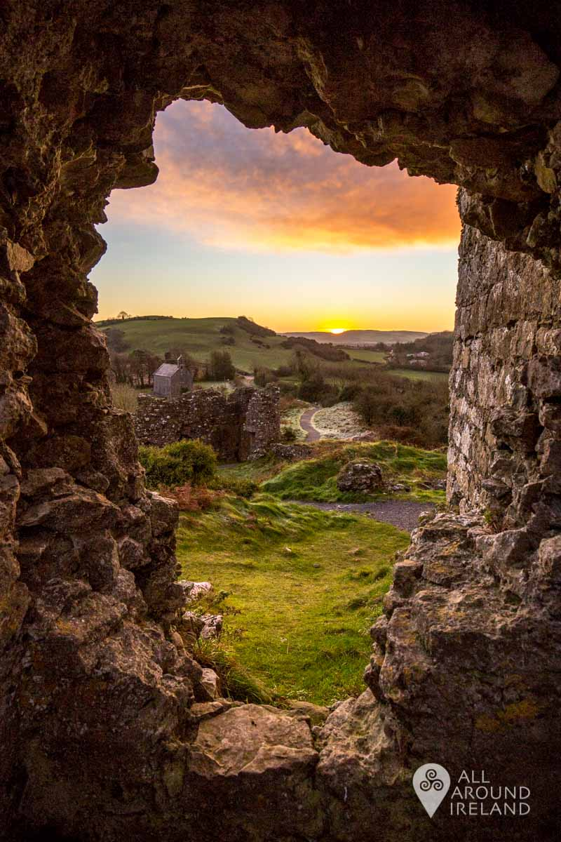A view through the ruins to the church and carpark at the Rock of Dunamase