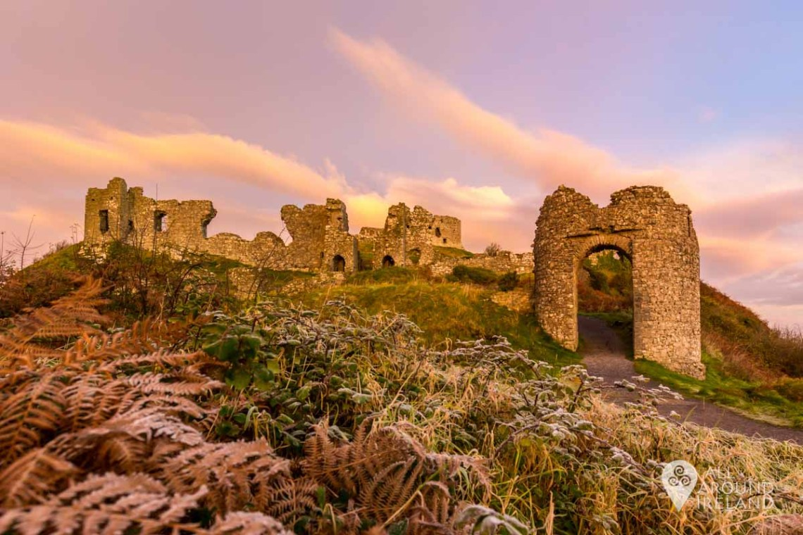 Pink sky at sunrise over the Rock of Dunamase