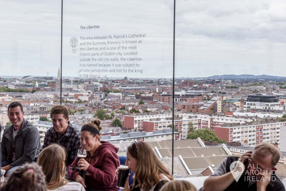 Looking out towards the Liberties area of Dublin from the Gravity Bar. A group on young people are sitting by the window enjoying their pints!