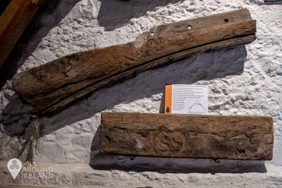 Wooden beams from St Canice's Cathedral mounted on the walls in Rothe House