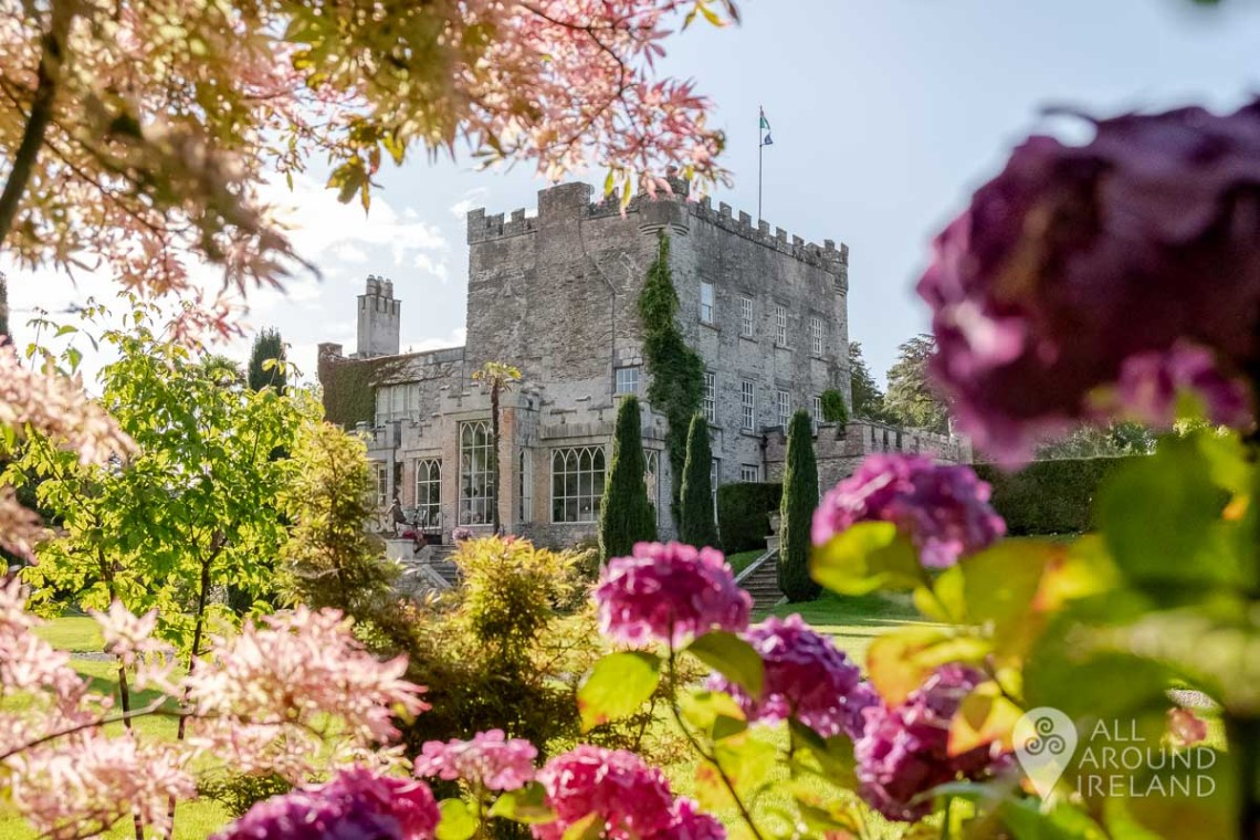 The castle viewed through beautiful pink blooms in the formal gardens.