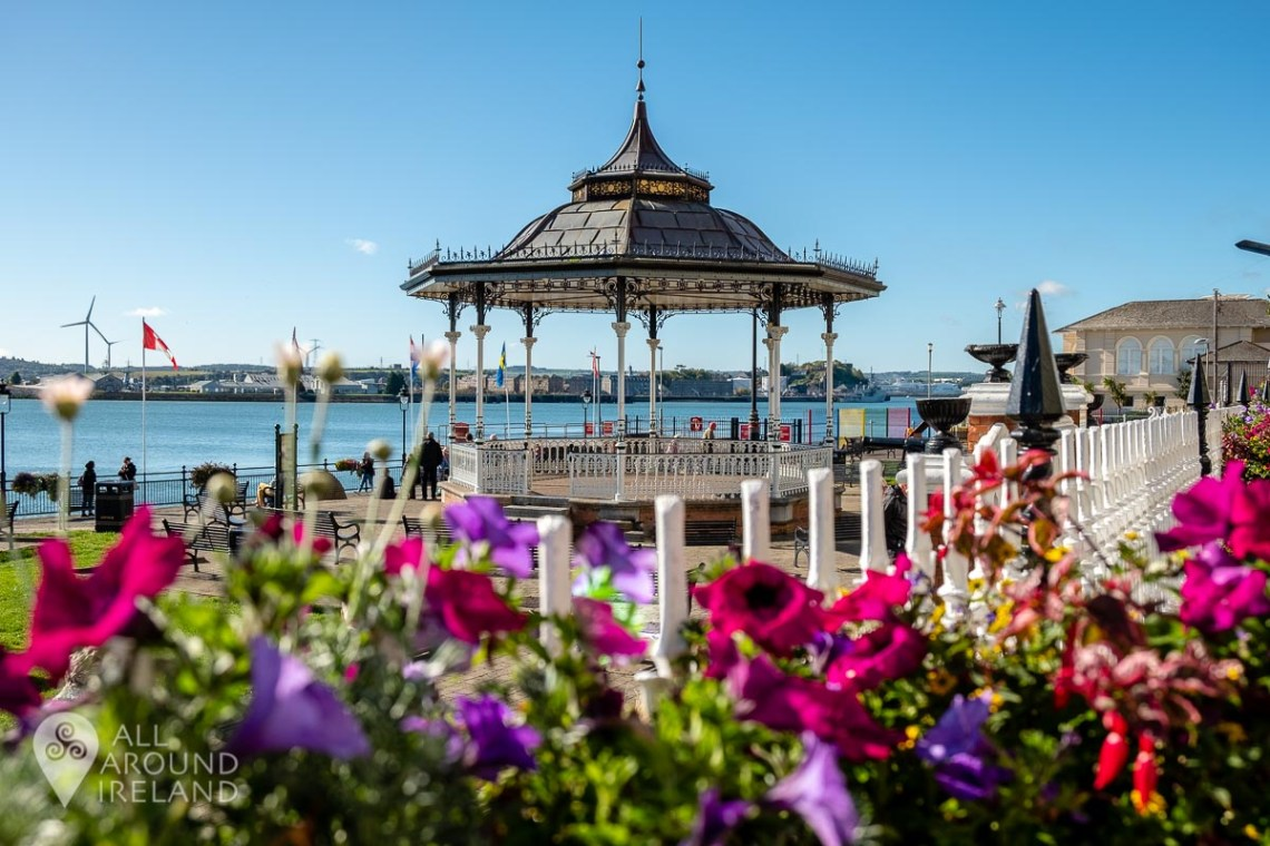 Colourful flowers adorn the gates at John F Kennedy Park in Cobh. The beautiful bandstand is in the background.
