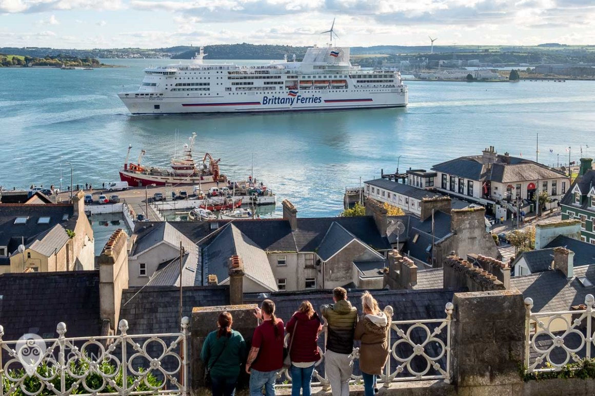A large cruise ship moves through Cobh Harbour