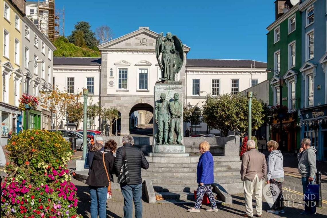 Tourists at the Lusitania Memorial in Cobh's Casement Square