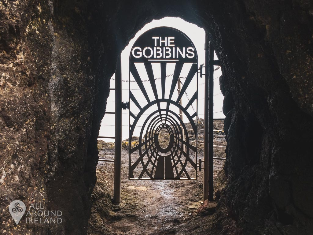 Looking through Wise's Eye, the short tunnel which gives you access to the Gobbins Path. A steel gate blocks the entrance to stop unauthorised entry.