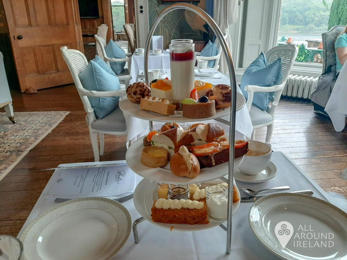 Three tiers of delights for afternoon tea on the table in the Blue Room at Castle Leslie