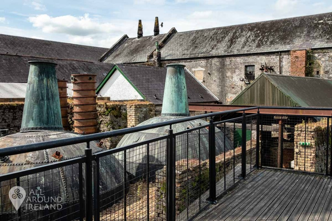 Large copper stills in the outdoor courtyard replacing the originals at Kilbeggan Distillery which were sold for scrap