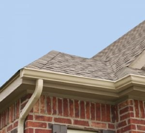 A gutter and downspout drainage system allows the rain water that hits the roof to drain away from your home.