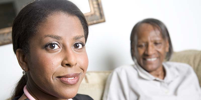 image of caregiver with client sitting on couch