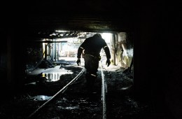 """A miner walks out of the Sewell """"R"""" coal mine, Tuesday, October 6, 2015, in Yukon, West Virginia. The coal industry is facing tough times across West Virginia. Photo: AP / David Goldman"""