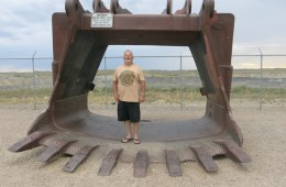 Miner Kent Parrish stands in a coal shovel at a roadside viewing platform for the Eagle Butte coal mine outside of Gillette, Wyoming. Photo: Leigh Paterson / Inside Energy