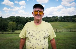 Terry Shanor, a beekeeper from Butler County, sports his favorite shirt at the annual picnic of the Pennsylvania State Beekepers Association. A co-op of beekeepers in the region are trying to breed tougher honeybees that can survive cold winters and fight back against parasitic mites. Photo: Lou Blouin