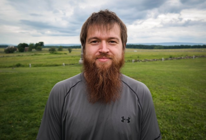 "Kyle Beger, 28, of St. Joseph, Missouri, visits ""The Angle"" at the Gettysburg battlefield, June 17, 2015. The site marks the place where Confederate soldiers briefly broke the Union line during Pickett's Charge on the third day of the battle. Photo: Lou Blouin"