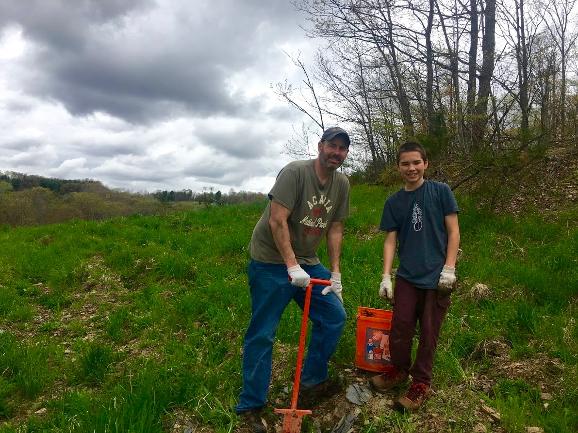 Ron and Trey Slavonic planting trees