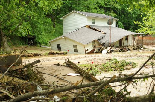 A flooded and damaged home in Pie, West Virginia, after devasting flooding of Pigeon Creek and others in Mingo County in May 2009. File Photo: Logan Banner