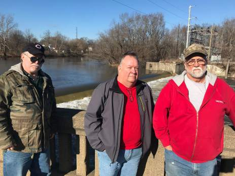 Jim Haslett, Mike Arnold and Russell St. Clair (left to right) oppose taking down the Leavittsburg dam because they may lose their fishing spot as well as the slow-moving water that allows them to float on pontoon boats. (Photo by Julie Grant/The Allegheny Front)